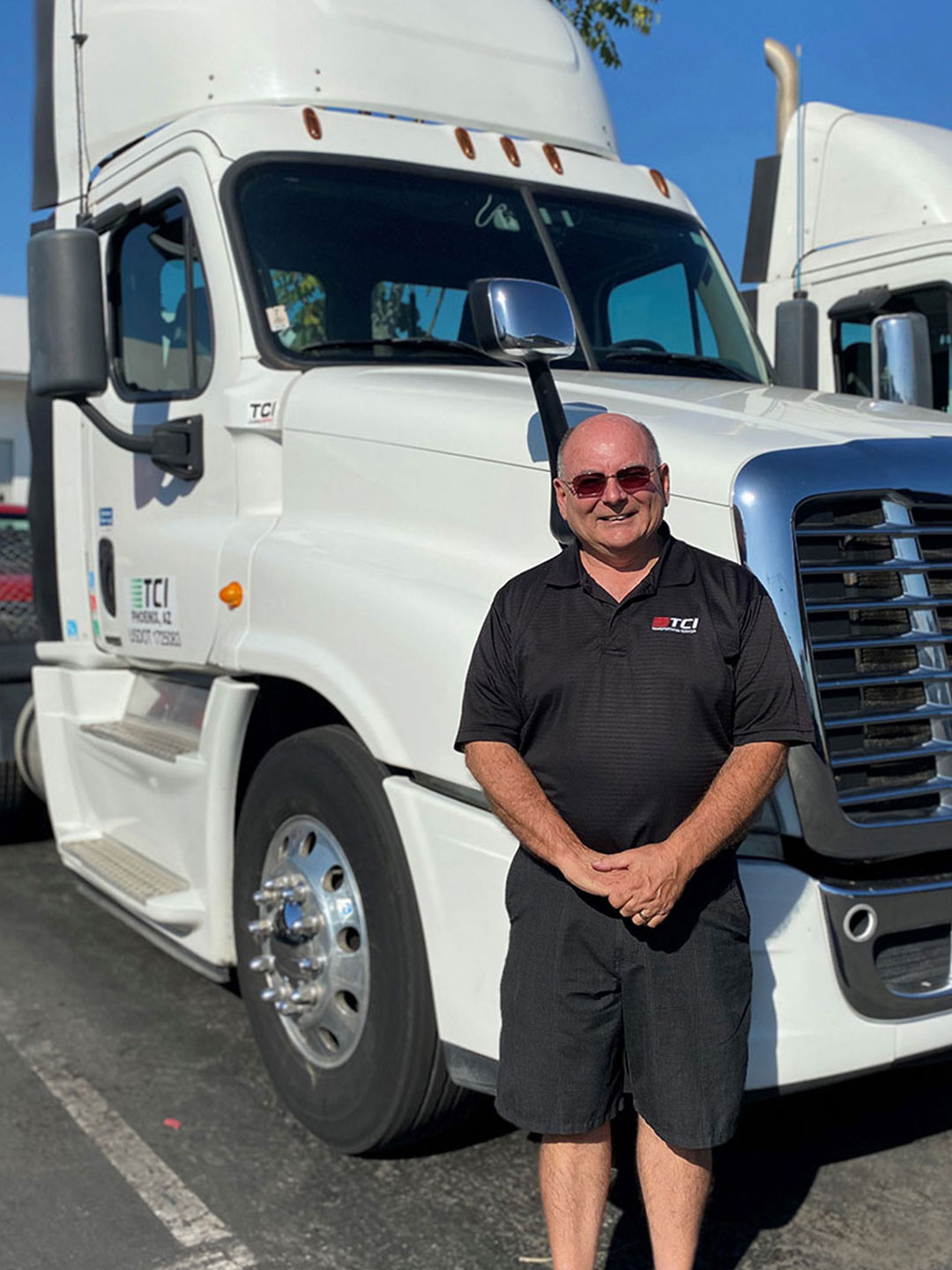 TCI Driver in front of Semi cab