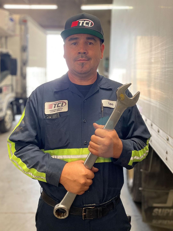 TCI Mechanic holding large wrench