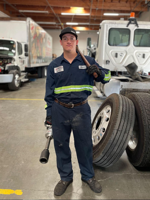 TCI Mechanic posing in garage